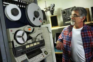 Looking at an old commercial tape machine that was used in TV studios, Ed DiMeglio, of RetroMedia, in Smithfield, converts sound and images stored on obsolete media into digital media. Andrew Dickerman/The Providence Journal
